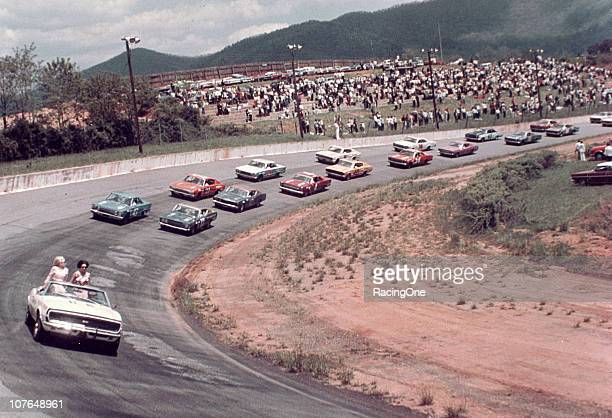 David Pearson and Richard Petty bring the field down for the start of the Fireball 300 NASCAR Cup race at AshevilleWeaverville Speedway Pearson went...