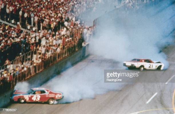 David Pearson driver of the Wood Brothers Mercury and Richard Petty driver of the STP Dodge crash during the1976 Winston Cup Daytona 500 at the...