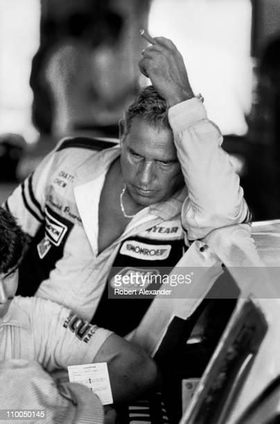 David Pearson leans against his race car in the Daytona International Speedway garage during a practice session for the 1985 Daytona 500 in February...