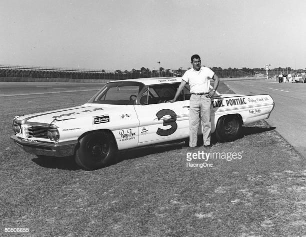 David Pearson poses for a portrait with his car the Ray Fox 1962 Pontiac at the Daytona International Speedway