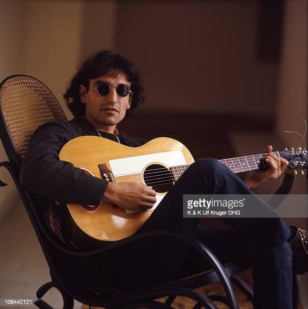 David Peel poses for a portrait playing acoustic guitar circa 1968 in Germany