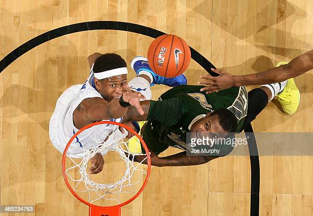 David Pellom of the Memphis Tigers jumps for a rebound against Victor Rudd of the USF Bulls on January 26 2014 at FedExForum in Memphis Tennessee...