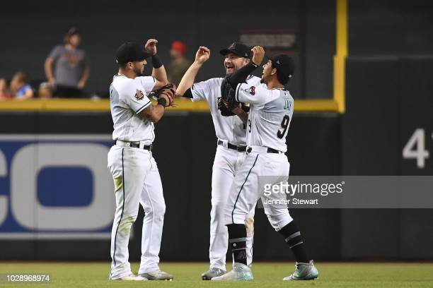 David Peralta AJ Pollock and Jon Jay of the Arizona Diamondbacks celebrate after closing out the MLB game against the Atlanta Braves at Chase Field...