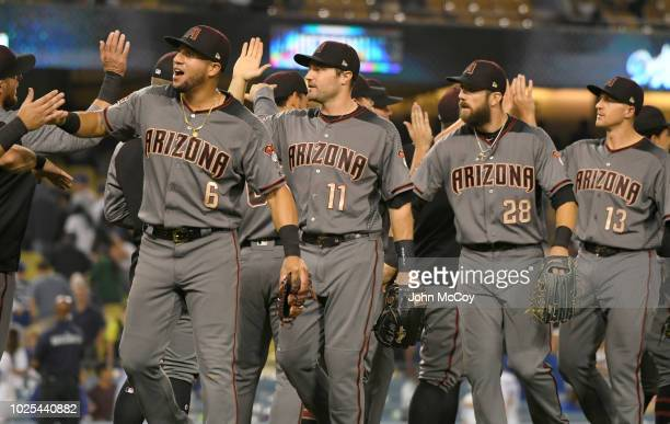 David Peralta AJ Pollock Steven Souza Jr and Nick Ahmed congratulate eachother on a 312 win over the Los Angeles Dodgers at Dodger Stadium on August...