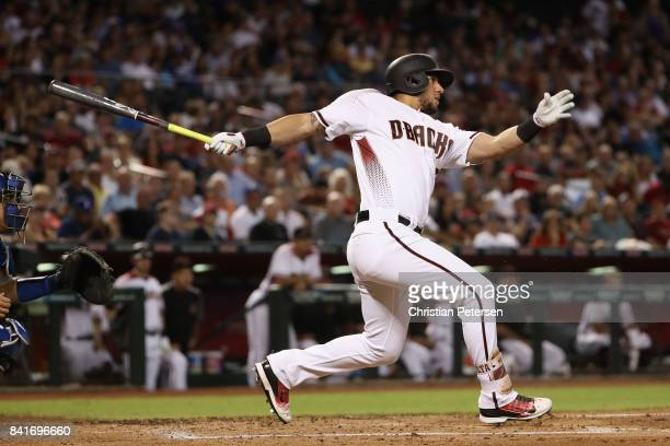 David Peralta of the Arizona Diamondbacks bats against the Los Angeles Dodgers during the MLB game at Chase Field on August 30 2017 in Phoenix Arizona