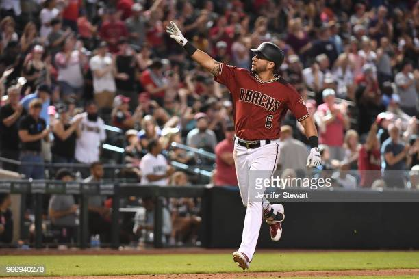 David Peralta of the Arizona Diamondbacks celebrates a solo home run in the eighth inning of the MLB game against the Miami Marlins at Chase Field on...