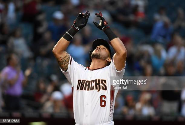 David Peralta of the Arizona Diamondbacks celebrates after hitting a first inning home run off of Jhoulys Chacin the San Diego Padres at Chase Field...
