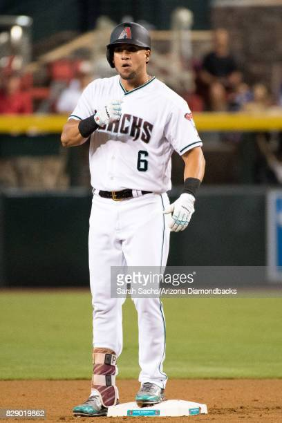 David Peralta of the Arizona Diamondbacks celebrates after hitting a leadoff double during a game against the Los Angeles Dodgers at Chase Field on...