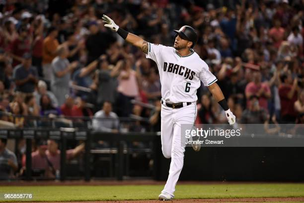 David Peralta of the Arizona Diamondbacks celebrates after hitting a solo home run in the third inning of the MLB game against the Miami Marlins at...