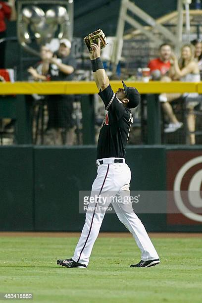 David Peralta of the Arizona Diamondbacks celebrates after making the game ending catch against the Colorado Rockies during the ninth inning of a MLB...