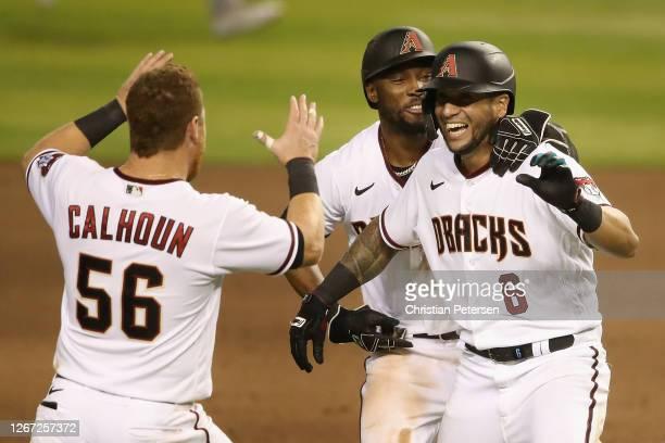 David Peralta of the Arizona Diamondbacks celebrates with Starling Marte and Kole Calhoun after a walk-off RBI single against the Oakland Athletics...