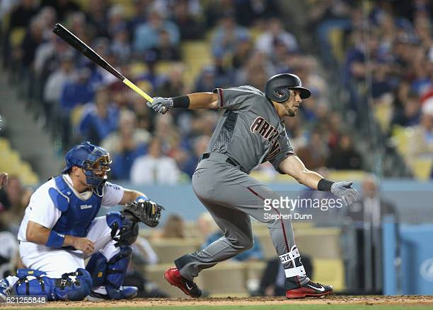 David Peralta of the Arizona Diamondbacks drives in a run from third with a ground out in the sixth inning against the Los Angeles Dodgers at Dodger...