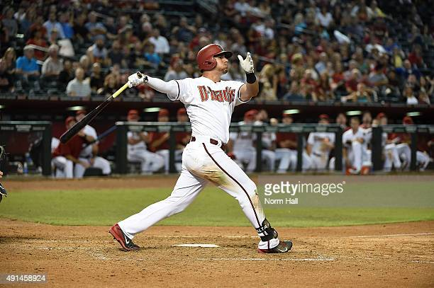 David Peralta of the Arizona Diamondbacks follows through on a swing against the Colorado Rockies at Chase Field on September 29 2015 in Phoenix...