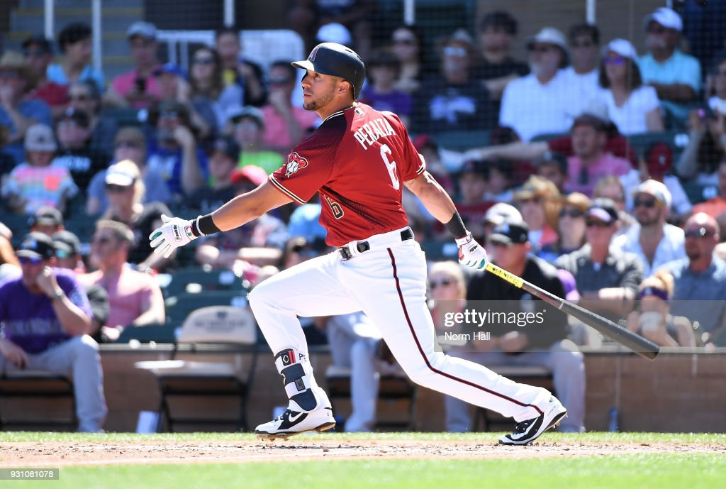 David Peralta #6 of the Arizona Diamondbacks follows through on a swing during the third inning of a spring training game against the Colorado Rockies at Salt River Fields at Talking Stick on March 12, 2018 in Scottsdale, Arizona.