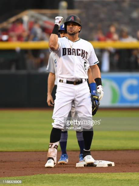 David Peralta of the Arizona Diamondbacks gestures to his dugout after hitting an RBI double during the first inning against the Los Angeles Dodgers...