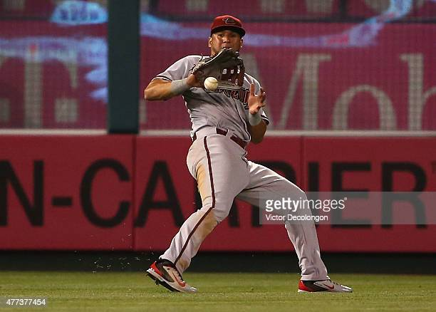 David Peralta of the Arizona Diamondbacks gets behind the bouncing ball on a line drive single to left center by Kyle Kubitza of the Los Angeles...