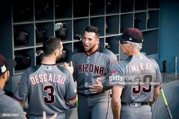 David Peralta of the Arizona Diamondbacks gets energized with teammate Daniel Descalso prior to Game Two of the National League Division Series...