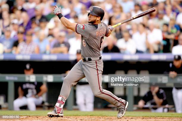 David Peralta of the Arizona Diamondbacks hits a RBI single in the fourth inning against the Colorado Rockies at Coors Field on June 21 2017 in...
