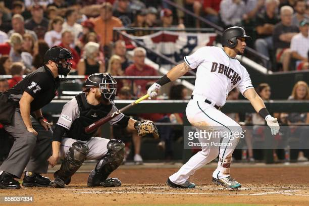 David Peralta of the Arizona Diamondbacks hits a single during the second inning of the National League Wild Card game against the Colorado Rockies...