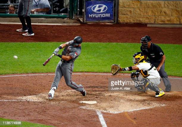 David Peralta of the Arizona Diamondbacks hits a three RBI triple in the seventh inning against the Pittsburgh Pirates at PNC Park on April 22 2019...