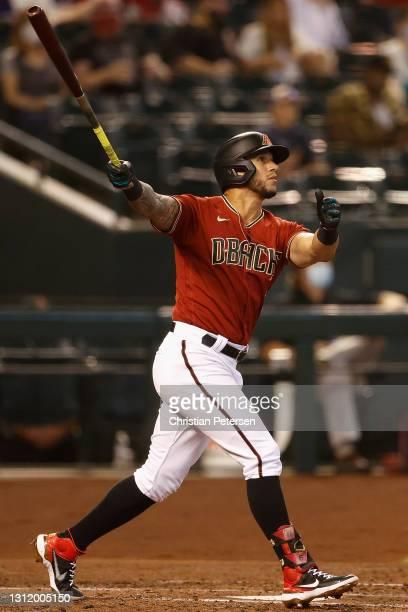David Peralta of the Arizona Diamondbacks hits a three-run home run against the Cincinnati Reds during the third inning of the MLB game at Chase...