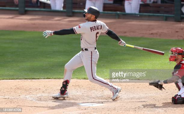 David Peralta of the Arizona Diamondbacks hits a triple in the 10th inning against the Cincinnati Reds at Great American Ball Park on April 22, 2021...