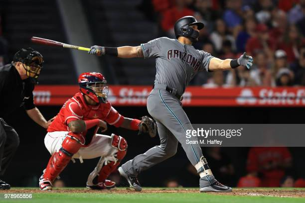 David Peralta of the Arizona Diamondbacks hits an RBI double as Martin Maldonado of the Los Angeles Angels of Anaheim looks on during the fifth...