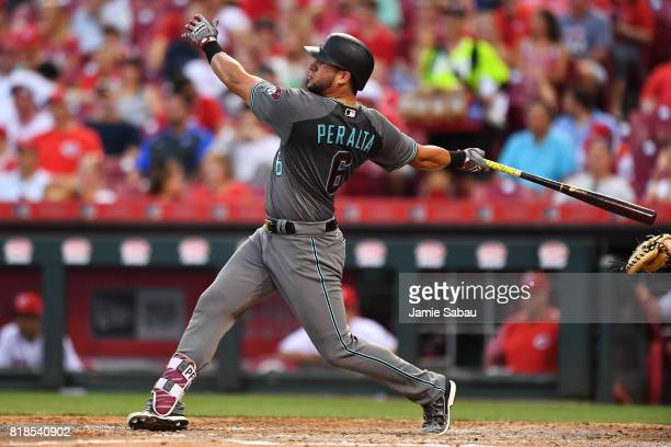 David Peralta of the Arizona Diamondbacks hits an RBI double in the fifth inning against the Cincinnati Reds at Great American Ball Park on July 18...