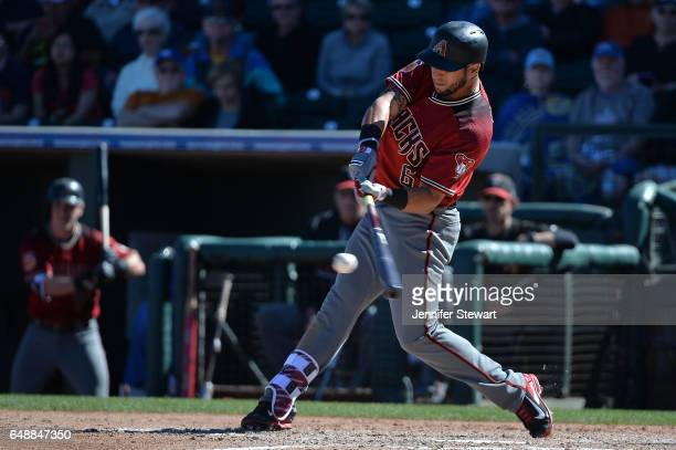David Peralta of the Arizona Diamondbacks hits an RBI single in the sixth inning of the spring training game against the Kansas City Royals at...