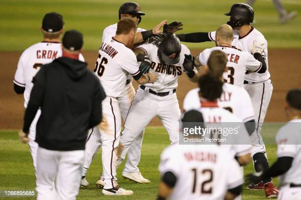 David Peralta of the Arizona Diamondbacks is congratulated by teammates after a walk-off RBI single against the Oakland Athletics during the ninth...