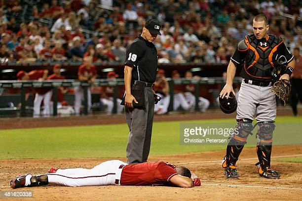David Peralta of the Arizona Diamondbacks lays motionless on the ground after being hit in the head by a pitch from starting pitcher Jose Fernandez...