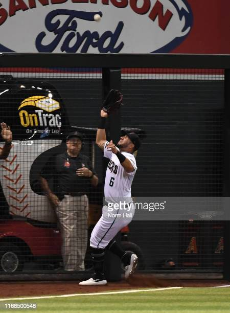 David Peralta of the Arizona Diamondbacks makes a catch at the left field fence on a fly ball hit by Alex Dickerson of the San Francisco Giants...