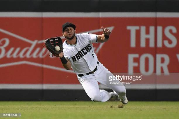 David Peralta of the Arizona Diamondbacks makes a diving catch in the ninth inning of the MLB game against the Atlanta Braves at Chase Field on...