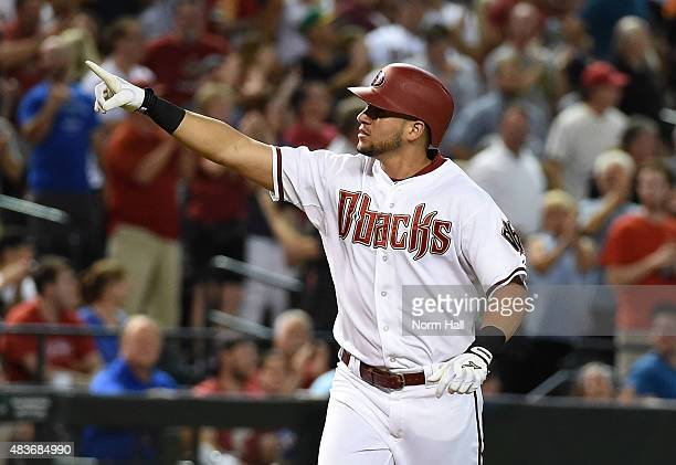 David Peralta of the Arizona Diamondbacks points to the crowd after hitting a second inning grand slam home run against the Philadelphia Phillies at...
