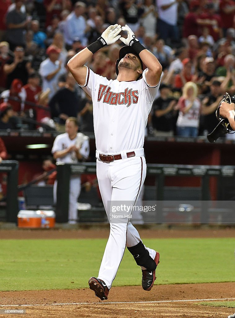 David Peralta #6 of the Arizona Diamondbacks points to the sky after hitting a second inning grand slam home run against the Philadelphia Phillies at Chase Field on August 11, 2015 in Phoenix, Arizona. Arizona won 13-1.