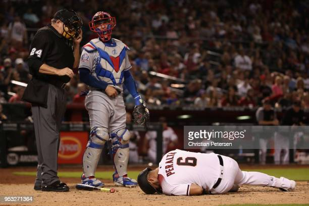 David Peralta of the Arizona Diamondbacks reacts after being hit by a pitch in fromt of catcher Yasmani Grandal of the Los Angeles Dodgers during...
