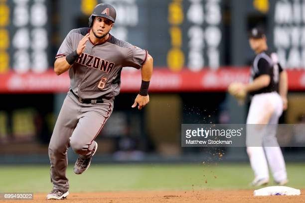 David Peralta of the Arizona Diamondbacks rounds second base in the fourth inning against the Colorado Rockies at Coors Field on June 21 2017 in...