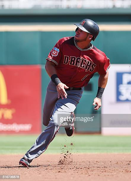 David Peralta of the Arizona Diamondbacks rounds second base on his way to third during the first inning of a spring training game against the...