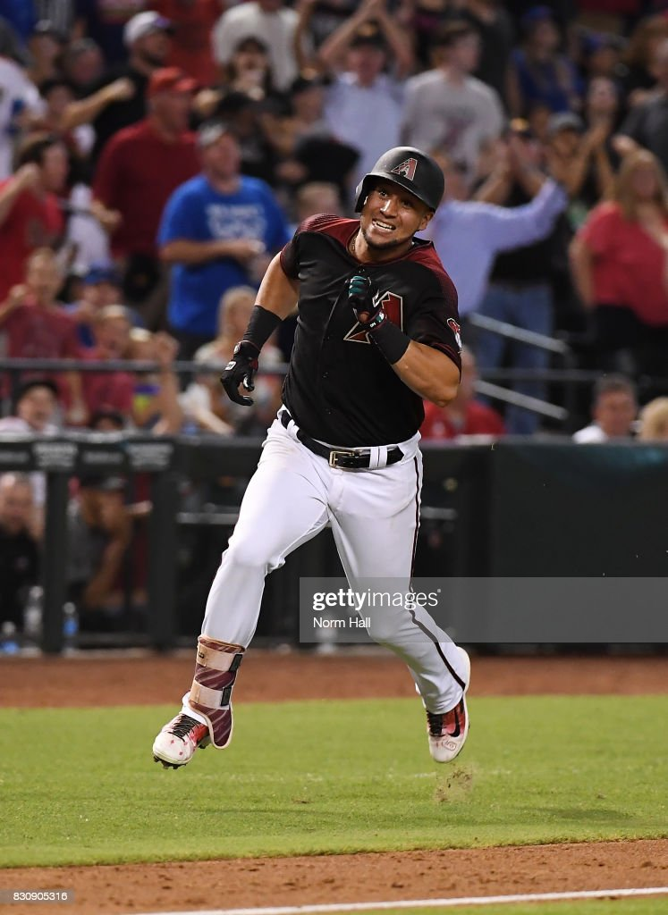 David Peralta #6 of the Arizona Diamondbacks rounds third base and scores on an inside the park home run during the eighth inning against the Chicago Cubs at Chase Field on August 12, 2017 in Phoenix, Arizona. Diamondbacks won 6-2.