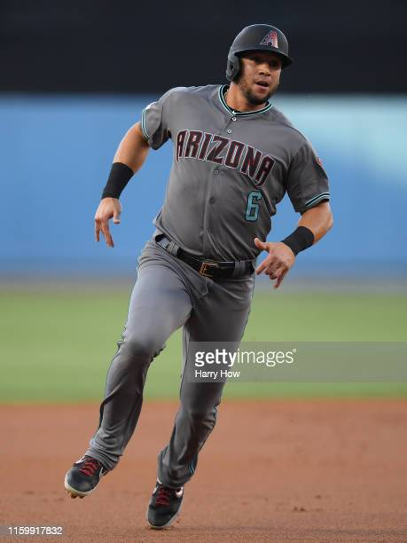 David Peralta of the Arizona Diamondbacks runs around third to score and take a 1-0 lead over the Los Angeles Dodgers during the first inning at...