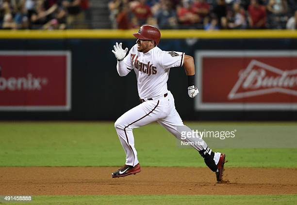 David Peralta of the Arizona Diamondbacks runs to third base against the Colorado Rockies at Chase Field on September 29 2015 in Phoenix Arizona