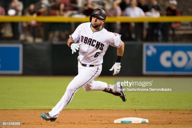 David Peralta of the Arizona Diamondbacks runs to third on an RBI triple during a game against the Los Angeles Dodgers at Chase Field on August 29...