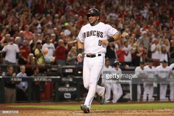 David Peralta of the Arizona Diamondbacks scores a run against the Colorado Rockies during the second inning of the National League Wild Card game at...