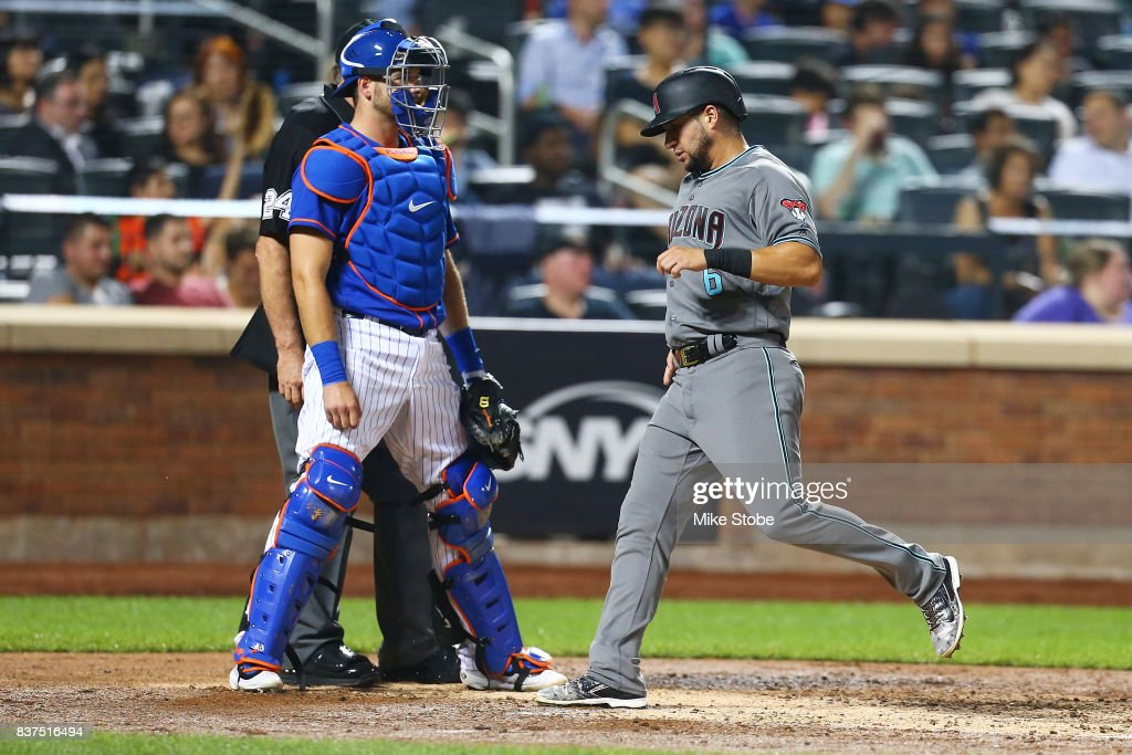 David Peralta #6 of the Arizona Diamondbacks scores on Paul Goldschmidt #44 RBI double in the fifth inning against the New York Mets at Citi Field on August 22, 2017 in the Flushing neighborhood of the Queens borough of New York City.