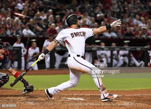 David Peralta of the Arizona Diamondbacks singles in a run during the fourth inning against the Atlanta Braves at Chase Field on July 24 2017 in...
