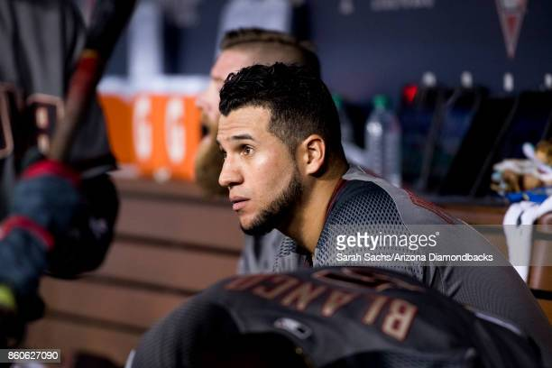 David Peralta of the Arizona Diamondbacks sits in the dugout during Game Two of the National League Division Series against the Los Angeles Dodgers...