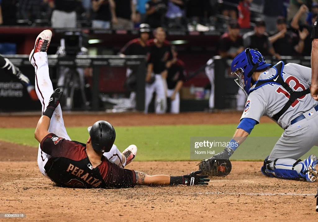 David Peralta #6 of the Arizona Diamondbacks slides into home an inside the park home run as Alex Avila #13 of the Chicago Cubs misses with the tag during the eighth inning at Chase Field on August 12, 2017 in Phoenix, Arizona. Diamondbacks won 6-2.