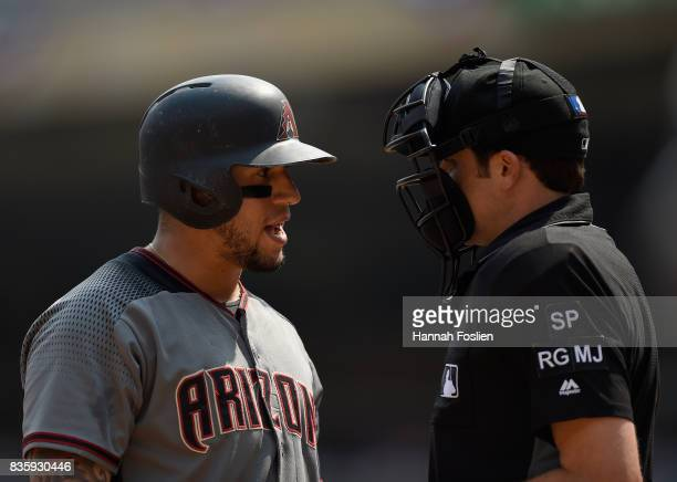 David Peralta of the Arizona Diamondbacks speaks with home plate umpire John Tumpane after striking out against the Minnesota Twins during the first...
