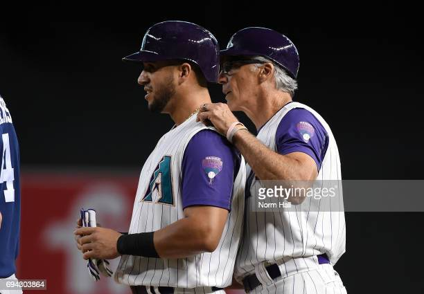 David Peralta of the Arizona Diamondbacks talks with first base coach Dave McKay after safely reaching base against the San Diego Padres at Chase...