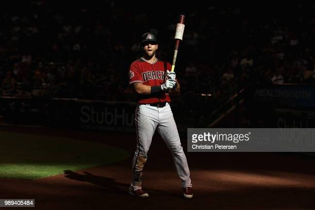 David Peralta of the Arizona Diamondbacks warms-up on deck during the ninth inning of the MLB game against the San Francisco Giants at Chase Field on...